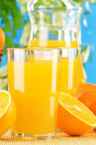 Two glasses of orange juice and fruits Stock Image