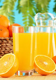 Two glasses of orange juice and fruits Stock Photography