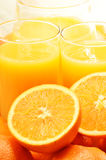 Two glasses of orange juice and fruits Royalty Free Stock Photo