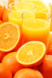 Two glasses of orange juice and fruits Royalty Free Stock Image