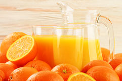 Two glasses of orange juice and fruits Stock Photo