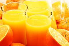 Two glasses of orange juice and fruits Royalty Free Stock Photography