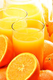 Two glasses of orange juice and fruits Royalty Free Stock Photos