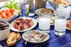 Two glasses of ouzo and appetizers Royalty Free Stock Image