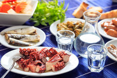 Two glasses of ouzo and appetizers Royalty Free Stock Images