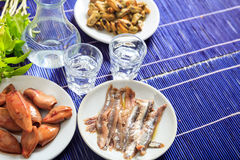 Two glasses of ouzo and appetizers Royalty Free Stock Photography