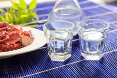 Two glasses of ouzo and appetizers Stock Image