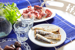 Two glasses of ouzo and appetizers Stock Photo