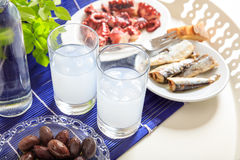 Two glasses of ouzo and appetizers Stock Photography