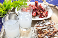 Two glasses of ouzo and appetizers Royalty Free Stock Photo