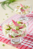 Two glasses of pink radish salad with cabbage Stock Images