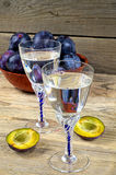 Two glasses of plum brandy with plums Stock Photography