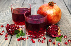 Two glasses of pomegranate juice Stock Images