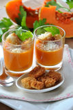 Two glasses with pumpkin soup and bread Stock Images