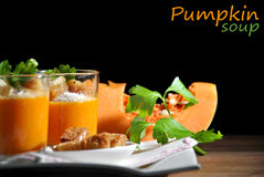 Two glasses with pumpkin soup and bread Royalty Free Stock Images