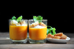 Two glasses with pumpkin soup and bread Royalty Free Stock Photography