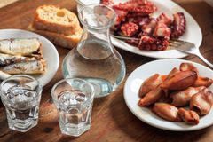 Two glasses of raki and appetizers Royalty Free Stock Photos