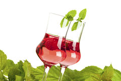 Two glasses of raspberry liqueur Stock Photography