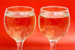 Two glasses on red Stock Photo