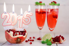 Two glasses with red champagne and candles 2015 Stock Photo