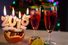 Two glasses with red champagne and candles 2015 Royalty Free Stock Image