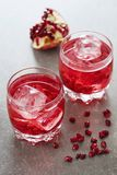 Two glasses of red cocktail stock photography