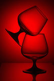 Two glasses in red light Royalty Free Stock Photography