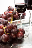Two glasses of red wine. Glasses of red wine with grapes Royalty Free Stock Photography