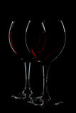 Two glasses of red wine on black. Background Stock Photography