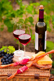 Two glasses of red wine with bottle,  bread, meat, grape and che Royalty Free Stock Photography