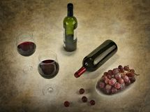 Two glasses of red wine with bottle and grapes. Two glasses of red wine with bottle and grapes Stock Photos