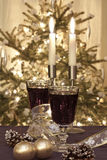 Two glasses of red wine with candles Royalty Free Stock Images