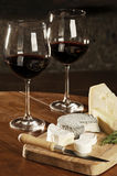 Two Glasses Of Red Wine And Cheese Royalty Free Stock Photo