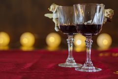 Two glasses of red wine with Christmas decoration royalty free stock image