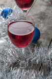 Two glasses of Red Wine and Christmas Ornaments Royalty Free Stock Photos