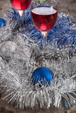 Two glasses of Red Wine and Christmas Ornaments Royalty Free Stock Photography