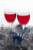 Two glasses of Red Wine and Christmas Ornaments Stock Images