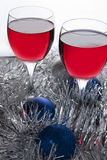 Two glasses of Red Wine and Christmas Ornaments Royalty Free Stock Images
