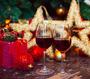 Two glasses of red wine on a Christmas tree background Stock Image