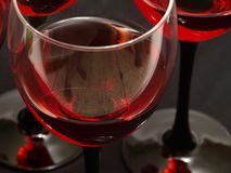Two glasses of red wine close-up over red backgrou Stock Images