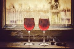 Valentine`s Day, wedding anniversary, betrothal, Two glasses of. Two glasses of red wine. Concept: love meeting royalty free stock images
