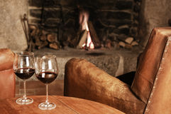 Two Glasses Of Red Wine At A Cosy Fireplace stock photos