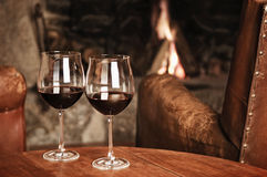 Two Glasses Of Red Wine At A Cosy Fireplace Stock Photography