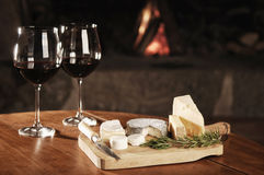 Two Glasses Of Red Wine At A Cosy Fireplace Royalty Free Stock Image