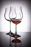 Two glasses with red wine, creating the illusion of four Stock Photography