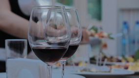 Two Glasses with Red Wine stock footage