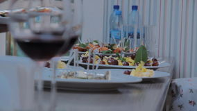 Two Glasses with Red Wine. Footage of stylish wine glasses for wine tasting in fine dining winery with wine on table. Australian tourism in Barossa, Clare stock video footage