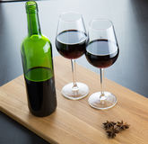 Two glasses with red wine. Two glases with red wine and three anise stars on wood surface Stock Images