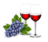 Two glasses of red wine with grapes. Royalty Free Stock Photos