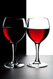 Two glasses of red wine isolated Royalty Free Stock Photos